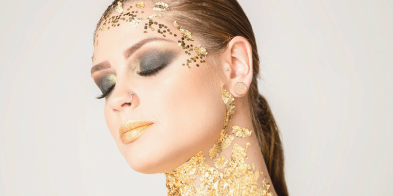 model with gold glitter