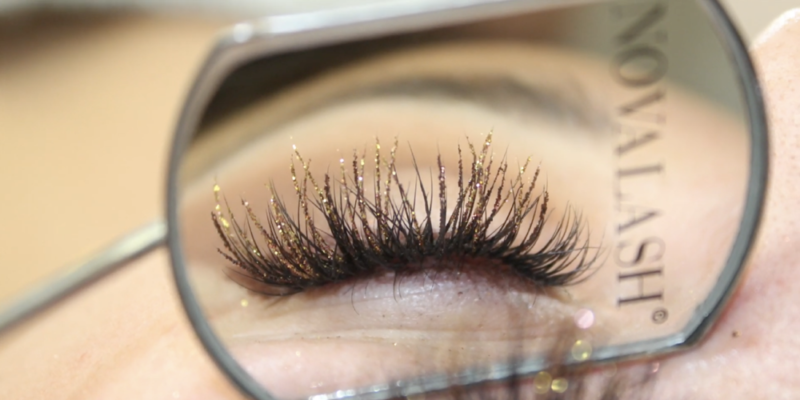 close up of glitter lashes in novalash mirror