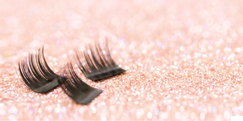 single lashes with glitter background