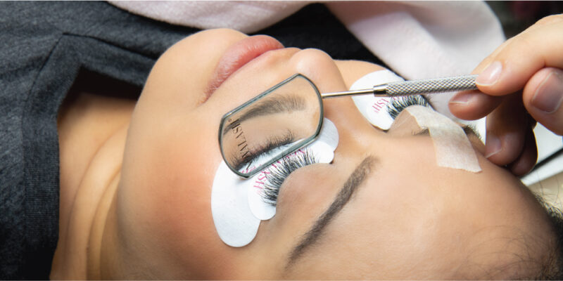 eyelash extensions being applied to woman